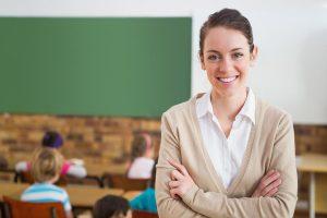 bigstock-pretty-teacher-smiling-at-came-69887626